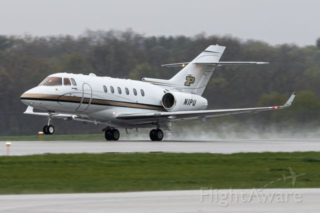 Raytheon Hawker 800 (N1PU) - Purdue's Hawker 900XP rotating off of 10 in some rainy/snowy conditions in April, bound for a slightly less formidable Tennessee.