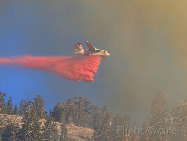 MARSH Turbo Tracker (N424DF) - Cal Fires Grumman S-2T Tanker 83... makes critical retardant drop on the threatening June Fire, June Lake CA. 9-16-14