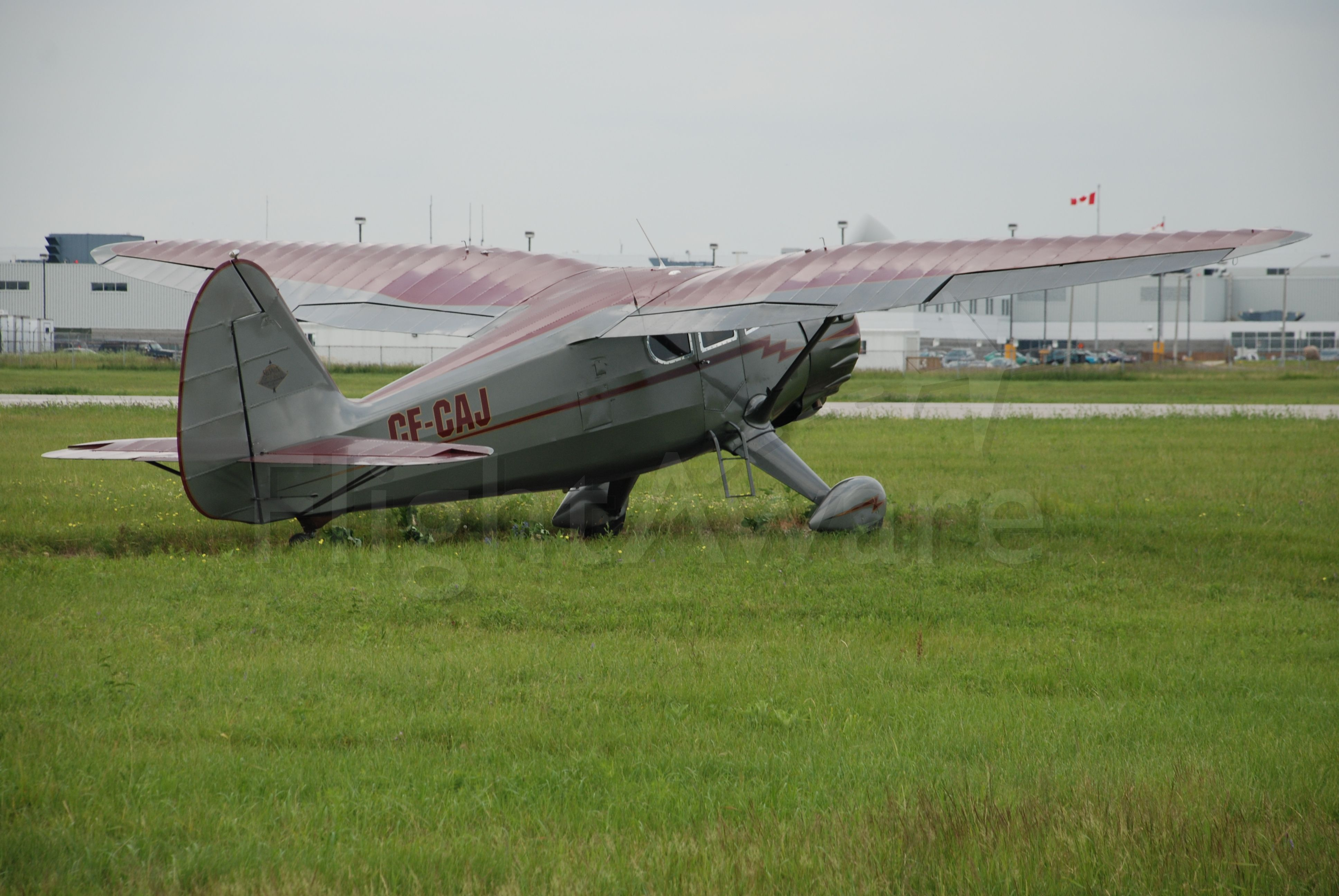 C-FCAJ — - Stinson V77 just completed two year restoration, cutting through the grass to the main runway at Downsview. July 11/08.