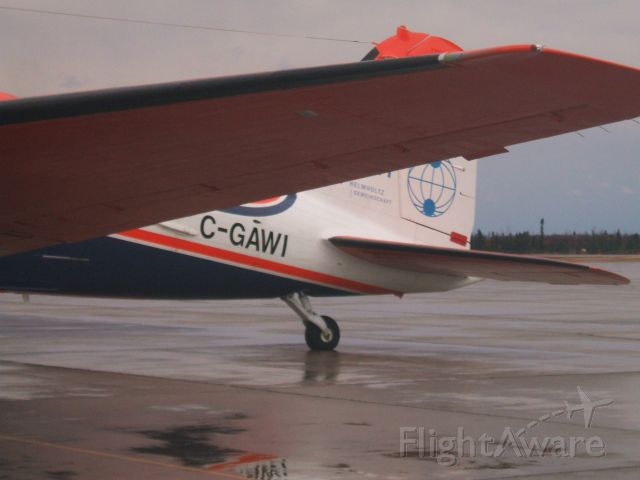 Douglas DC-3 (C-GAWI) - Parked at Woodward Aviation F.B.O.  Goose Airport NL.  Oct29/08
