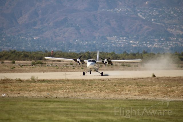 De Havilland Canada Twin Otter (N926MA) - Touching down on the dirt strip after a load of skydivers