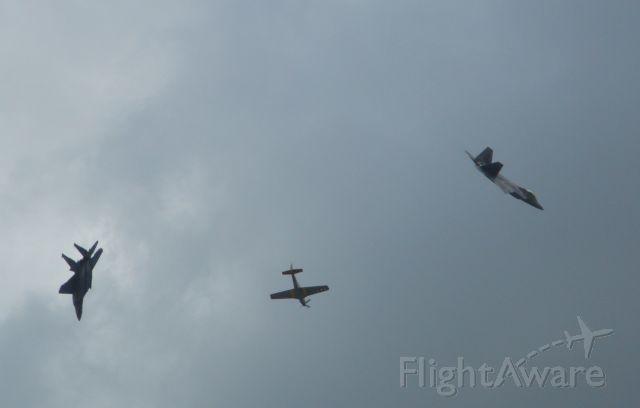 — — - F-22, P-51 and F-15 break following Heritage Flight over Charleston AFB
