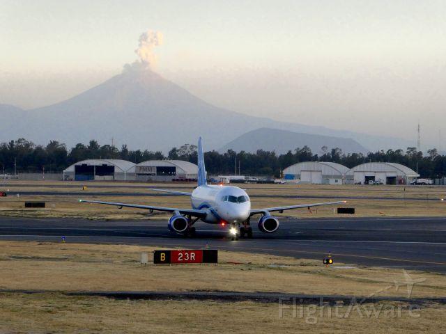 Sukhoi Superjet 100 (XA-ALJ) - The eruption of Popocatepetl in the background, after a 7.2 oscillatory earthquake...
