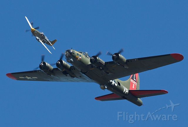 """Boeing B-17 Flying Fortress (N7227C) - B-17G Flying Fortress """"Texas Raiders"""" being escorted by little friend """"Charlotte's Chariot II"""" a P-51D at the 2018 Commemorative Air Force Wings Over Dallas airshow (Please view in """"full"""" for highest image quality)"""
