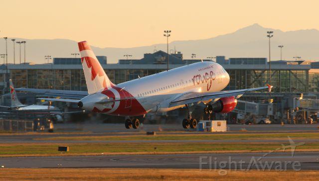 Airbus A319 (C-GBIJ) - Sunset landing at YVR 26R from PANC