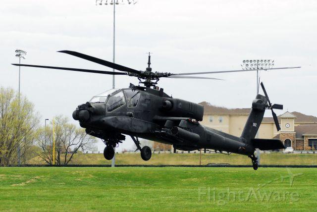 — — - AH-64 landing at the University of Central Missouri.