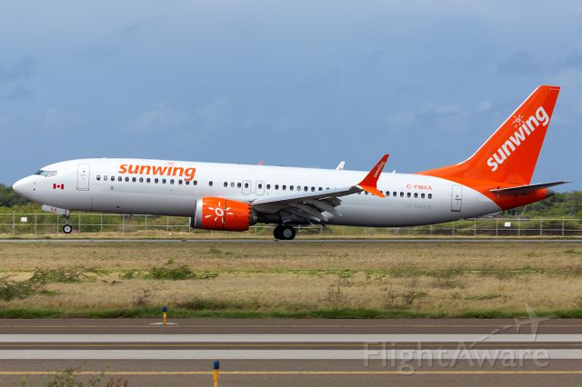 Boeing 737-700 (C-FMXA) - For the 1st time Sunwing touches down in Aruba.