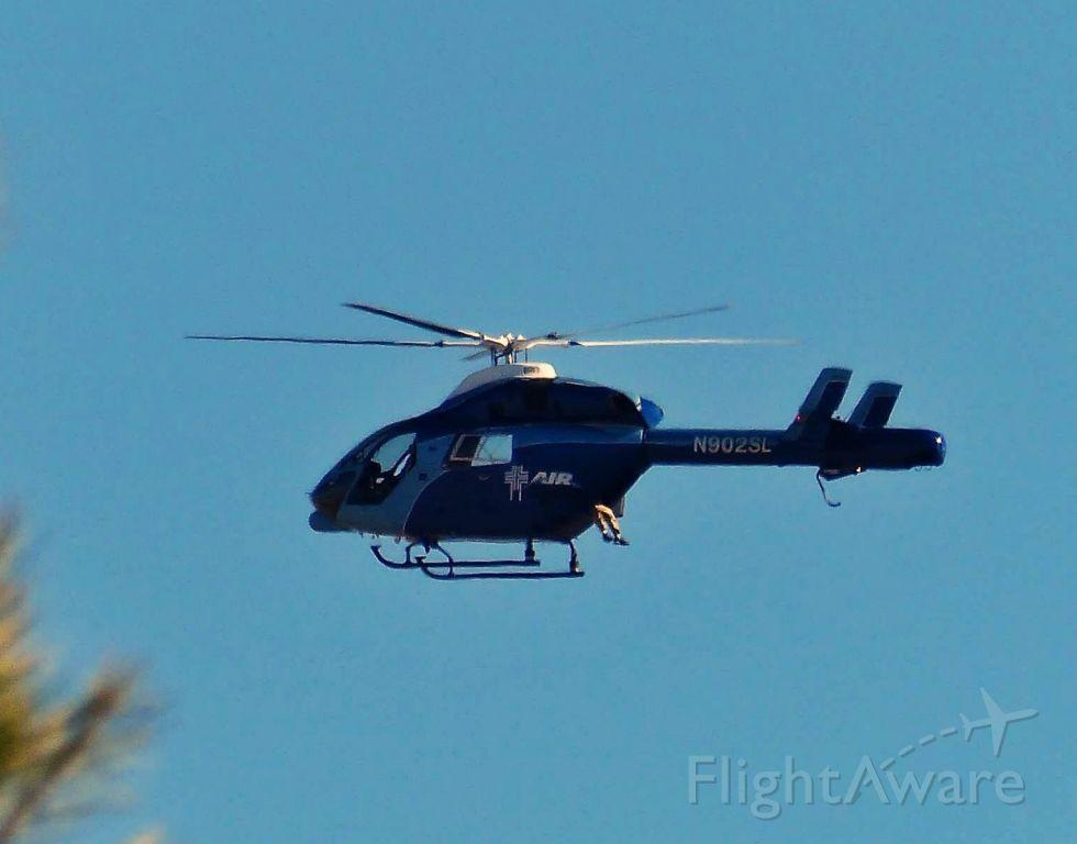 Cessna Citation II (N902SL) - N902SL - 1995 McDonnell Douglas MD900 surveying land above Yucca Valley CA