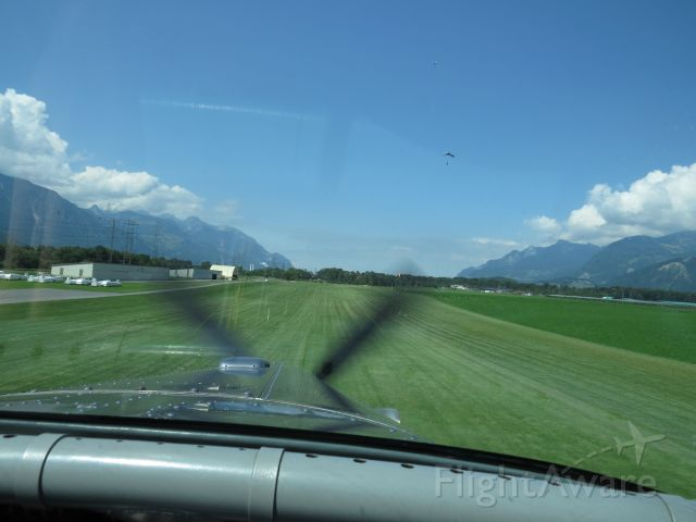 """Pilatus PC-6B Turbo-Porter (HB-FLI) - Landing on the turf runway before the skydivers we dropped off. The Porter is famous for its own """"skydiving""""."""
