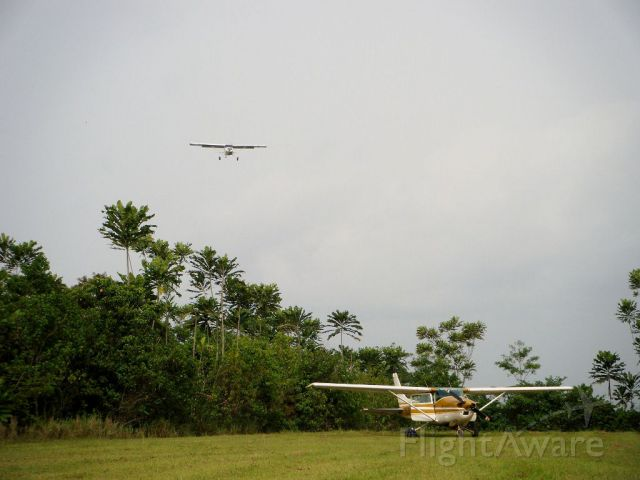 "MAULE MT-7-260 Super Rocket (N1052U) - Maule MX7 landing in Dizangué Cameroon. Photo taken with a 150$ Fujifilm Z33...planning on investing in a ""real"" camera !"