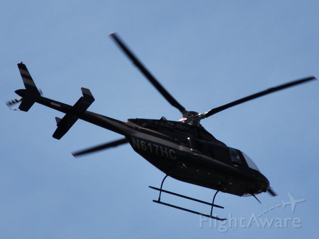 Bell 407 (N617HC) - LAND AIR GROUP INC - Buzzing the tree tops over Huntersville, NC - 2/20/09