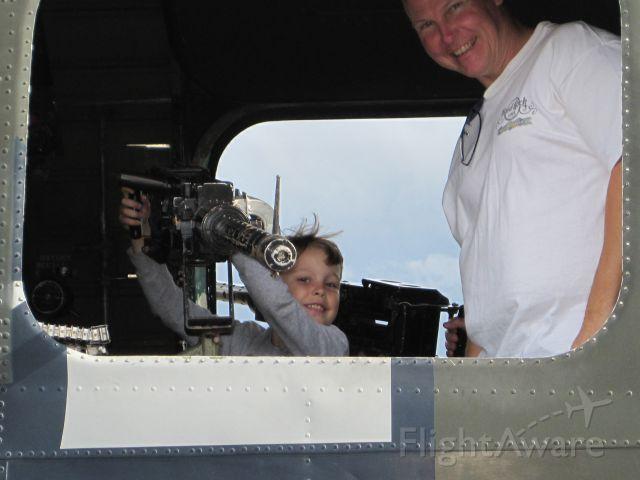 — — - Little boy manning the waist gun on a B-24.