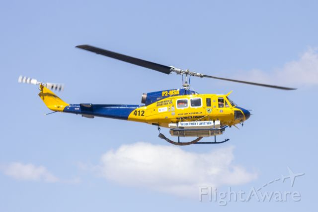 Bell BigLifter (P2-MSA) - McDermott Aviation (P2-MSA) Bell 214B departing Wagga Wagga Airport
