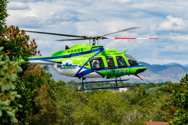Bell 407 (N776AL) - Landing at Arapahoe Community College in Littleton, CO for a public relations show and tell.