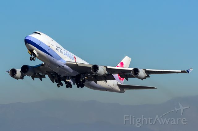 Boeing 747-400 (B-18723) - Mid afternoon departure from Rwy 25L, shot from Imperial Hill.