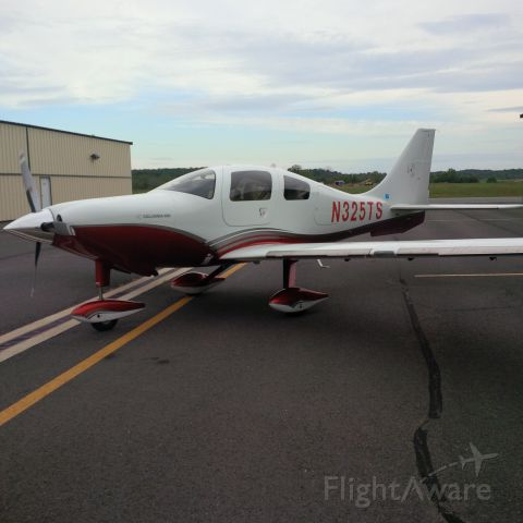 Cessna 400 (N325TS) - Fastest fixed gear single engine piston in production...  She even looks fast just sitting on the tarmac.