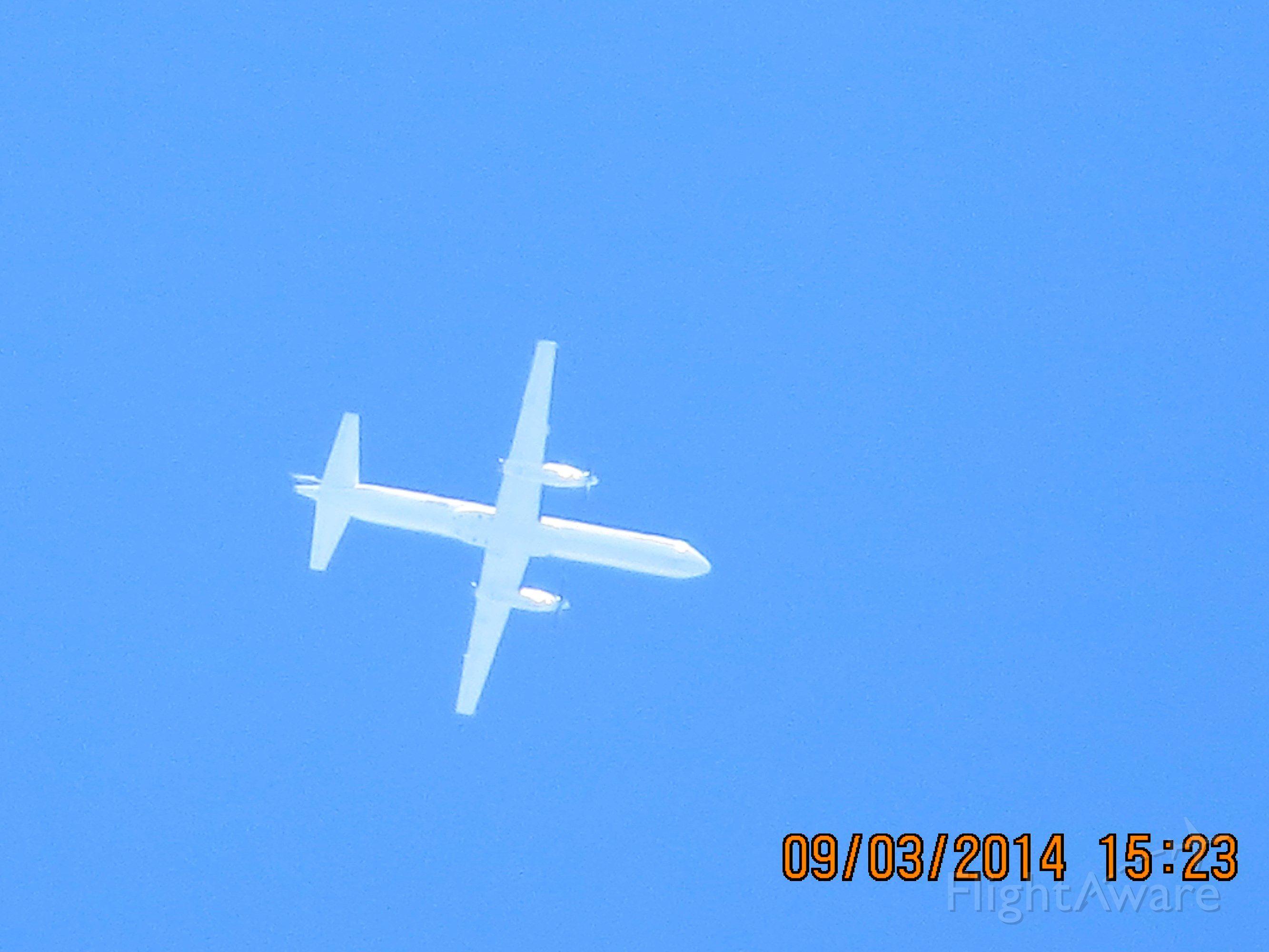 Saab 2000 (N814BB) - Saab 2000 from MOT to LFT over Baxter Springs KS (78KS) at 31k feet.