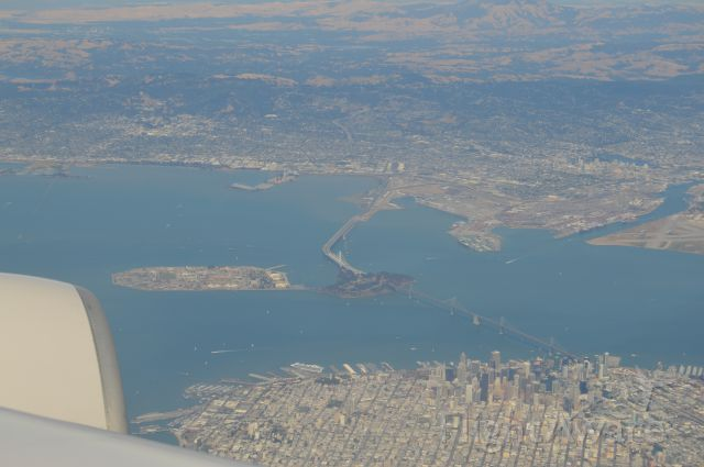 — — - View of downtown San Francisco and Bay Bridge. Landing into SFO, United 59 from Frankfurt.