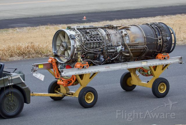 """— — - A J79, the engine that powers the mighty F-4 Phantom (amongst other aircraft), being towed to the engine shop at Hyakuri for work (please view in """"full' for highest image quality)"""