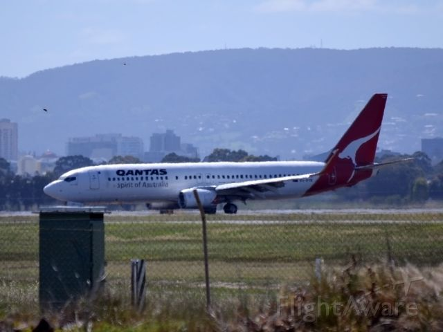 Boeing 737-800 (VH-VYE) - On taxi-way heading for Terminal 1, after landing on runway 23.