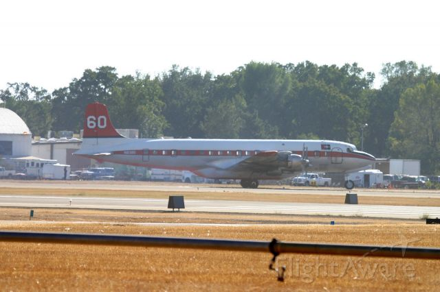 Douglas DC-7 (N838D) - KRDD - Tanker 60 rolling to the hot load zone at Redding for more juice to help fight the Boles Fire at Weed,CA Sept 2014.
