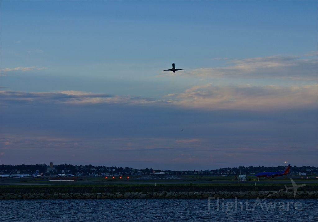 — — - A little regional jet departing before the Virgin Atlantic 744.