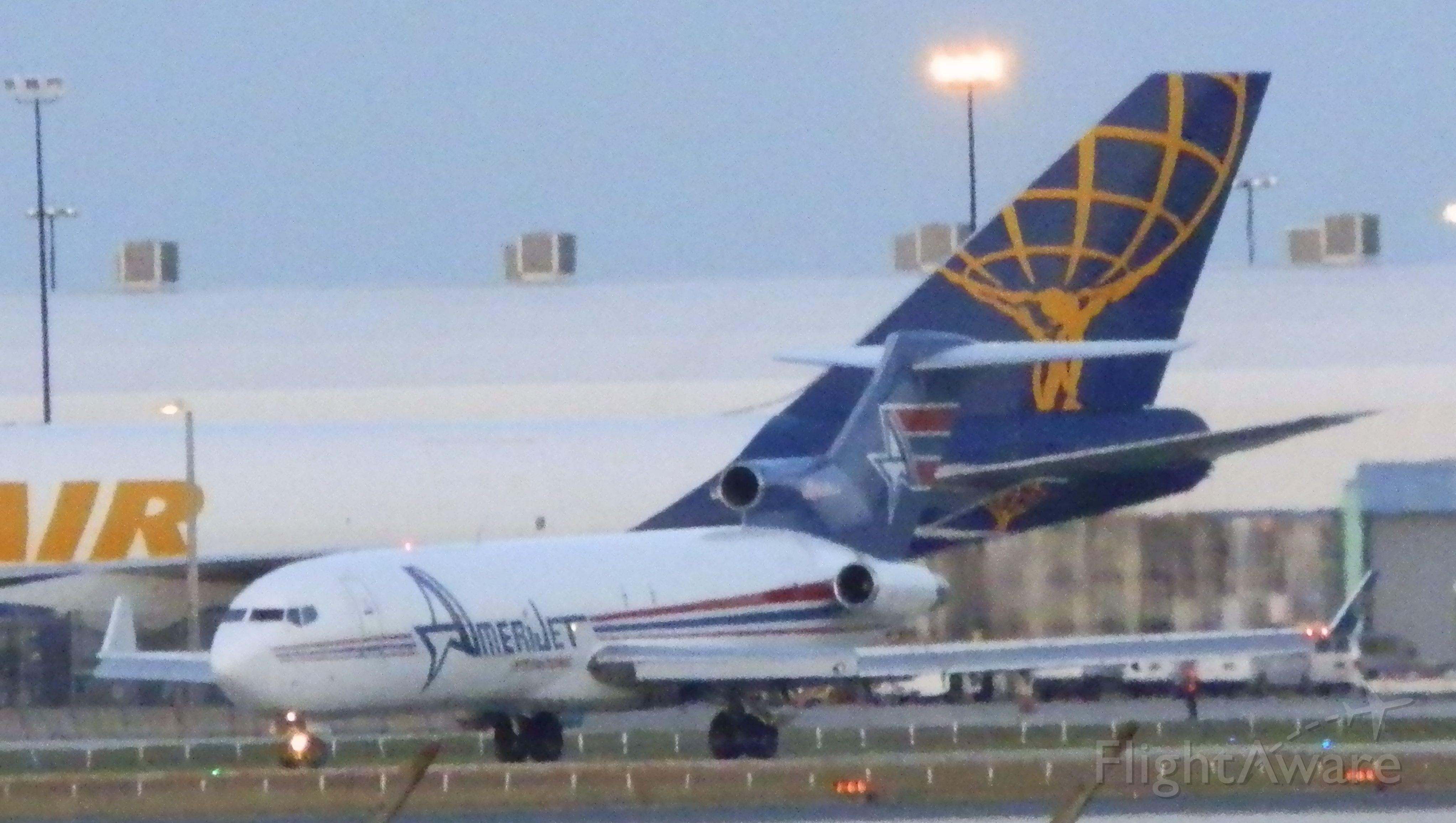 BOEING 727-200 (N395AJ) - What a size comparison!!!