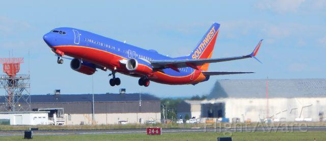 Boeing 737-800 (N8629A) - Scimitars lifting out of BDL - Taken 08-14-14