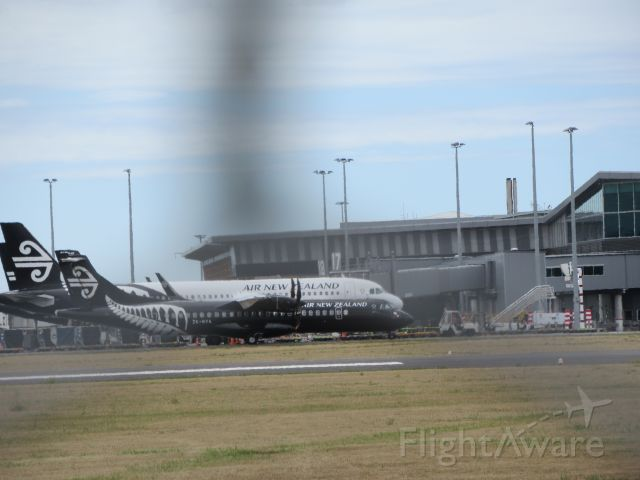 Aerospatiale ATR-72-600 (ZK-MVA) - At Gates. ATR 72 Passes A Air New Zealand A320 (ZK-OXC) While Taxiing to Gate.
