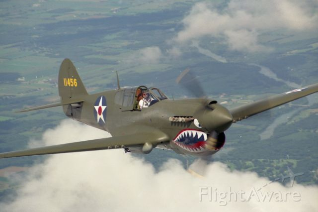 CURTISS Warhawk — - I took this picture of my Dad flying this aircraft over Janesville, WI