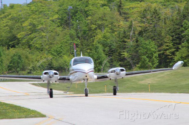 Cessna 310 (N4258C) - Taxiing to runway 8 at Mackinac Island, flying back to Ludington    (KLDM) on 6/27/16
