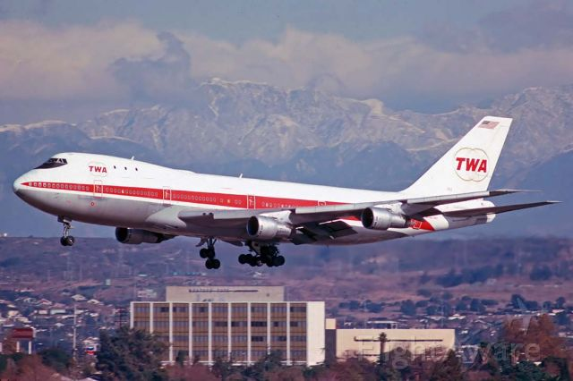 BOEING 747-100 (N93113) - TWA 747-131 N93113 on approach to land at Los Angeles International on December 29, 1974. It first flew on October 5, 1970. Its construction number is 20080. It was delivered to TWA on October 22, 1970. TWA returned it to Boeing on March 31, 1975. Boeing converted it to a freighter and sold it to the Iranian Air Force as 5-282 in May 1975. It is used as a tanker.