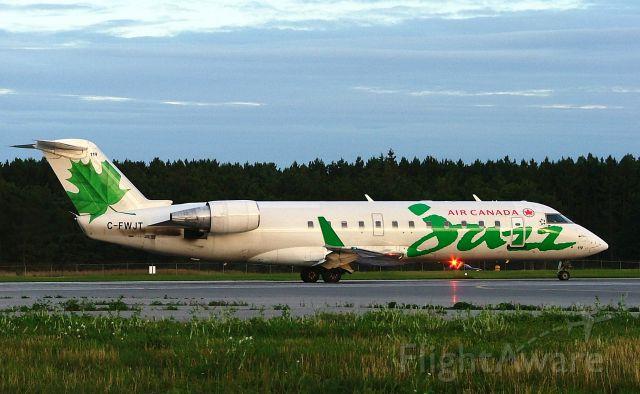 Canadair Regional Jet CRJ-200 (C-FWJT) - Awaiting clearance on Rwy 25.