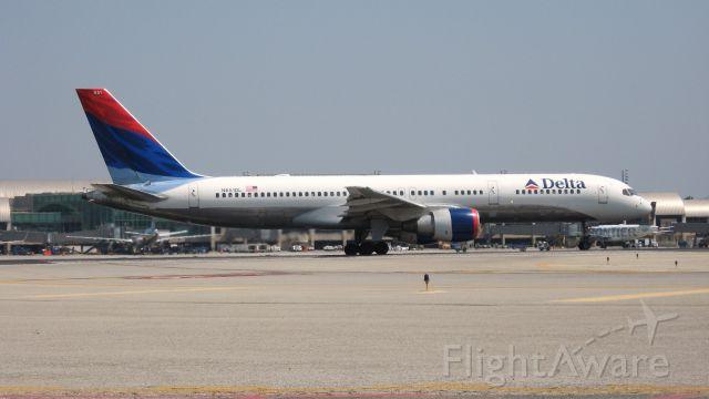 Boeing 757-200 (N651DL) - Holding on RWY 19R