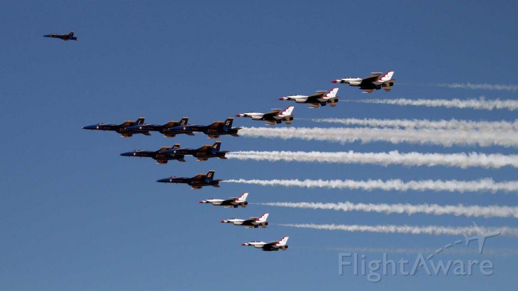 — — - USN Blue Angels and USAF Thunderbird Super Delta flyby.
