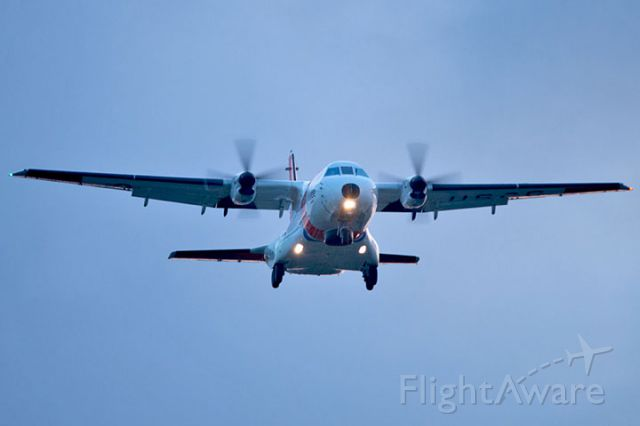 CG2302 — - 4/10/13:  U. S. Coast Guard HC-144A Ocean Sentry #CG-2302 on short final approach over Miami Lakes at sunset enroute to runway 9-left at Opa-locka Executive Airport, home to Coast Guard Air Station Miami.