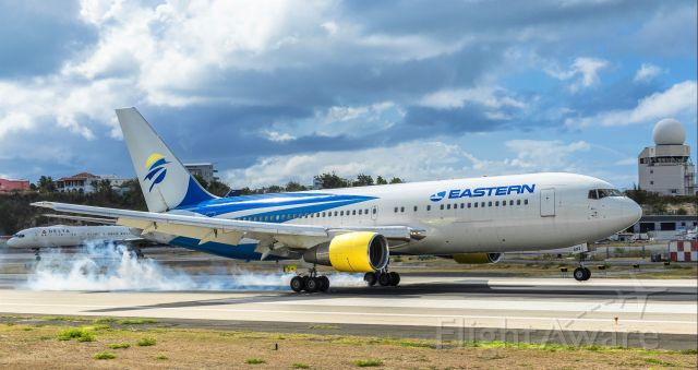 BOEING 767-200 (N602KW) - Eastern Airlines boeing 767-200 flying for sunwing airlines seen making positive contact with her main landing gears at TNCM St Maarten 09/05/2019