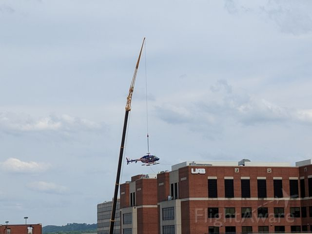 — — - Helo being lifted off the roof of UAB