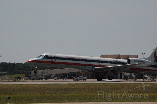 Embraer ERJ-135 (N828AE) - The landing after a C152 induced go around.