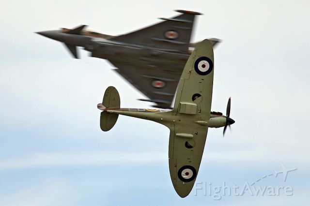 SUPERMARINE Spitfire — - History and the Present.  RAF Typhoon and Spitfire cross each other at RIAT 2015, Fairford, UK.