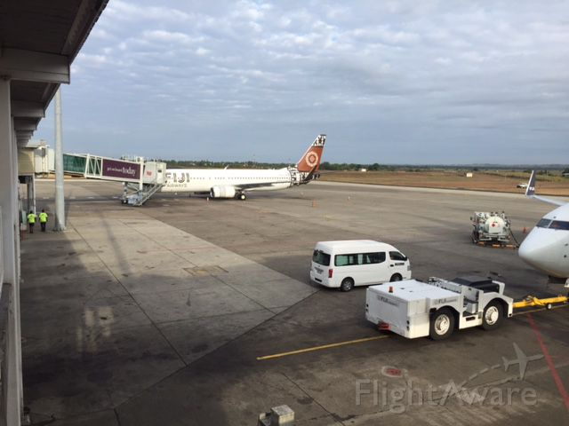 Boeing 737-800 (DQ-FJM) - ANOTHER SHOT OF THE DEPARTURE OF DQ-FJN you can see the nose our flight FJ911 to YSSY and DQ - FJM at gate 4 departure for Brisbane from Nadi Airport 2016
