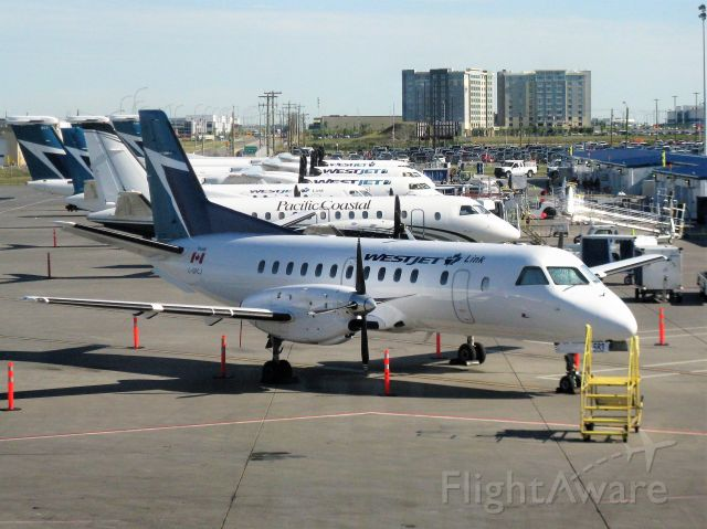 Saab 340 (C-GPCJ) - Westjet Link aircraft lineud up at YYC (recently transferred from pacific Coastal Airlines so they have not repainted all of them yet)