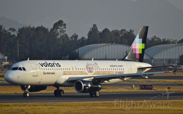 Airbus A320 (N505VL) - Volaris A320-233, airframe 4798 with Guatemala - Alux Nahual livery, landing on 05R runway at Mexico City Airport.