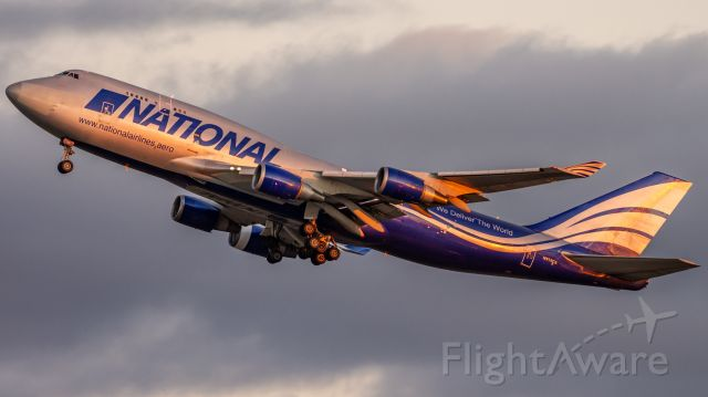 Boeing 747-400 (N919CA) - N919CA Getting airborne as the sun sets from Perth bound for Hong Kong after dropping a load of Fire Retardant off.