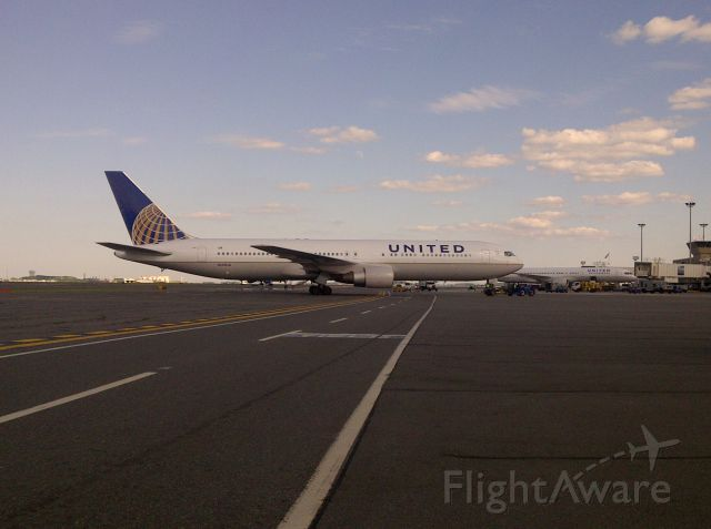 BOEING 767-300 (N643UA) - A United 767-300 gets towed into gate C17