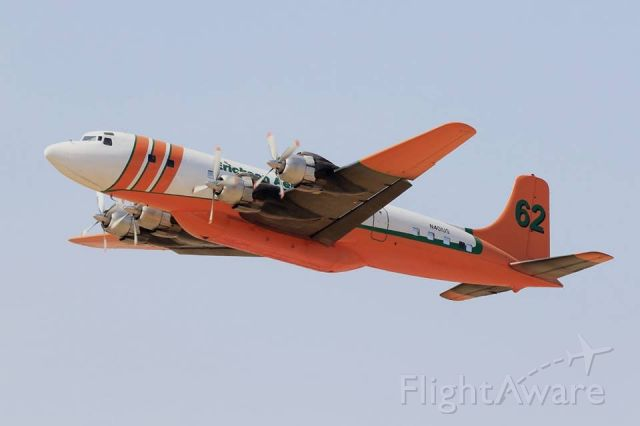 Douglas DC-7 (N401US) - One of Erickson's three DC-7 firefighting aircraft taking off to fight the Santa Rose firestorm of October, 2017.