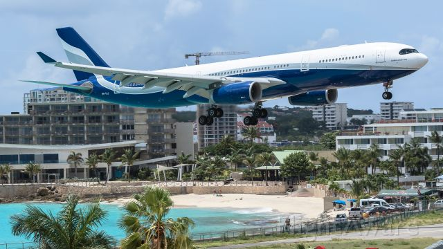 Airbus A330-300 (9H-TAJ) - Hi Fly Airbus A330-343 Malta registered 9H-TAJ over maho beach for landing.<br />Aircraft flew from Porto (OPO) to Princess Juliana Int (TNCM).<br />31/08/2020<br />For a video of its departure please visit my youtube channel and subscribe. <br />It's aviationtncm.