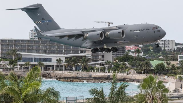Boeing Globemaster III (08-0001) - Multi National Air force 08-0001 SAC heavy airlift wing C17 over maho beach for landing with supplies for the fight against COVID19 from Holland for the Islands.<br />SAC01 on her first ever visit to the Caribbean.