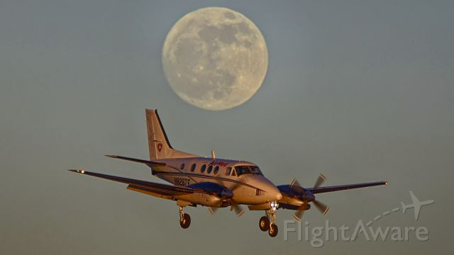 Beechcraft King Air 90 (N8287E) - 22 approach at sunset under the rising moon on Winter Solstice.