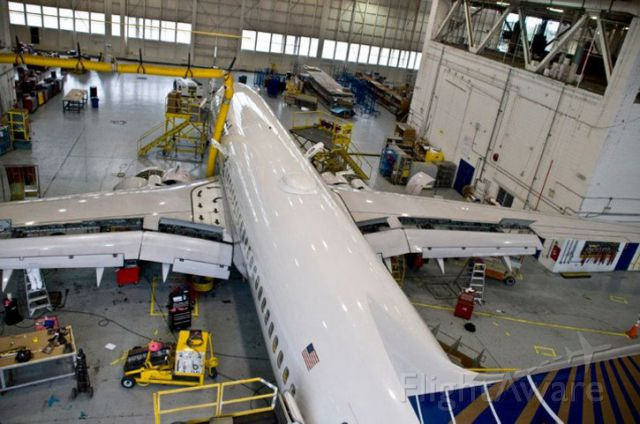 Boeing 737-800 — - A Continental B738 1 year prior to becoming a United plane.  In the south heavy mod maintenance hanger at MCO